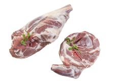 Fresh uncooked spring lamb shoulder and leg isolated on a white background. Fresh uncooked spring lamb shoulde and legt isolated on white background Royalty Free Stock Photography