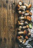 Fresh uncooked white forest mushrooms on wooden background Stock Images