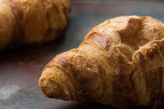 Fresh unfilled croissants for breakfast Stock Image