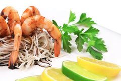 Fresh unshelled boiled shrimps with spaghetti. Stock Photo