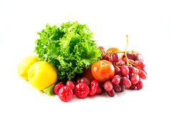 Fresh vagetable. A photo of fresh lettuce and some kind of fruit that is lemon,grape,apple,nose apple,tomato Stock Photos
