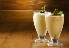 Fresh vanilla milkshake glasses Royalty Free Stock Photography
