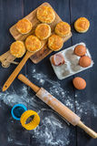 Fresh vanilla scones, eggs and rolling pin for dough. Royalty Free Stock Photo