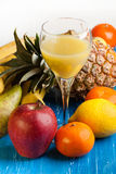 Fresh various fruits with juice Stock Images