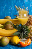 Fresh various fruits with juice Stock Photography