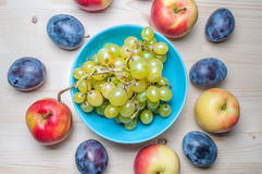 Fresh various fruits on wooden table Royalty Free Stock Photos
