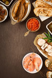 Fresh Various Tapas on Wooden Table Stock Image