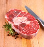 Fresh veal shank meat with herb on wood background Royalty Free Stock Photography