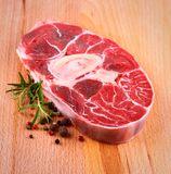 Fresh veal shank meat with herb on wood background Royalty Free Stock Photos