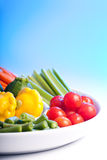 Fresh veg. Selection of fresh veg on a spiral white plate Stock Photography