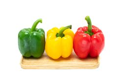 Fresh colorful bell peppers isolated on white background Stock Photo