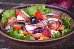 Fresh vegetable colorful greek salad in pate Royalty Free Stock Images