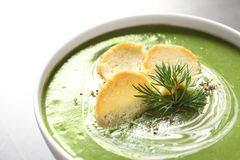 Fresh vegetable detox soup with croutons in dish. Closeup royalty free stock images