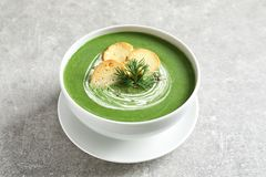 Fresh vegetable detox soup with croutons in dish. On table royalty free stock photography