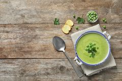 Fresh vegetable detox soup made of green peas in dish served on table, top view. With space for text royalty free stock photo