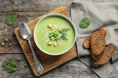 Fresh vegetable detox soup made of green peas. Served on table, top view royalty free stock image