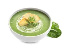 Fresh vegetable detox soup made of spinach with croutons in dish and leaves. On white background stock photos