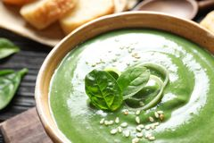 Fresh vegetable detox soup made of spinach in dish on table. Closeup stock images