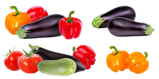 Fresh vegetable eggplants, tomatoes and red pepper isolated on w. Hite background Stock Images