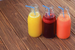 Fresh vegetable and fruit juice. In bottles Royalty Free Stock Photography