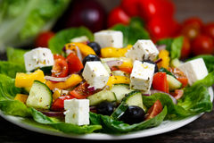 Fresh Vegetable Greek Salad with Feta cheese, black olives, olives oil,  tomatoes, yellow pepper, onion, cucumber. Royalty Free Stock Photos