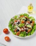 Fresh vegetable Greek salad with oil bottle. White background Stock Images