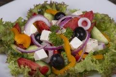 Fresh vegetable greek salad on the table Stock Photo