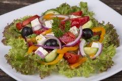 Fresh vegetable greek salad on the table Stock Photography
