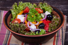 Fresh vegetable greek salad on the table Stock Image