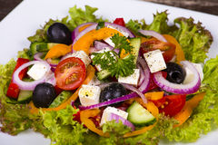 Fresh vegetable greek salad on the table Stock Images