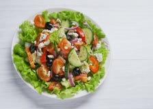 Fresh vegetable Greek salad, top view. Fresh vegetable Greek salad, white background, top view Stock Images