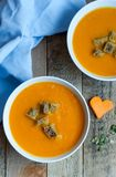 Fresh vegetable homemade pumpkin soup. With bread in the white bowls made by mum Stock Photography