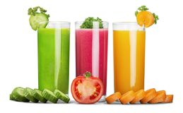 Fresh vegetable juices isolated on white royalty free stock photography