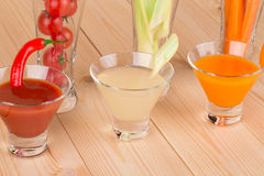 Fresh vegetable juices on table Stock Photos