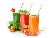 Fresh vegetable juices. Tomato, cucumber, carrot Royalty Free Stock Photo