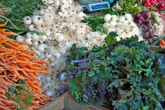Fresh vegetable at the market. Fresh carrots, onions and cabbage for sale at the farmer's market Royalty Free Stock Photography