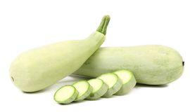 Fresh vegetable marrow and slices. Isolated on a white background Stock Photo