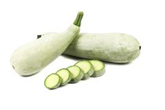 Fresh vegetable marrow and slices. Isolated on a white background Royalty Free Stock Images