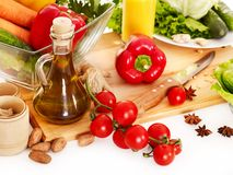 Fresh vegetable and olive oil. Royalty Free Stock Images