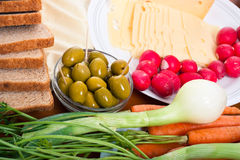 Fresh vegetable, olives, cheese and bread Stock Photography