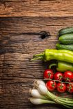 Fresh vegetable onion cucumber pepper and tomatoes on rustic oak Royalty Free Stock Photo