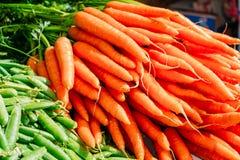 Fresh Vegetable Organic Green Beans And Orange Carrots. Fresh Vegetables Organic Green Beans And Orange Carrots. Production Of Local Food Market Stock Photos