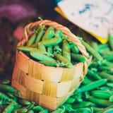 Fresh Vegetable Organic Green Beans In Wicker Basket. Stock Photo