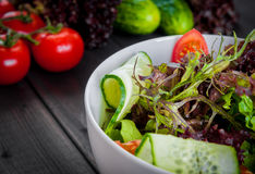 Fresh vegetable organic salad, healthy food. Fresh vegetable salad,healthy food, organic cucumbers, tomatoes and salad leaves Royalty Free Stock Images