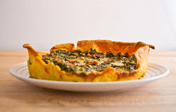 Fresh vegetable and prosciutto crudo quiche tart Stock Photo