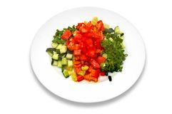Fresh vegetable salad. Salad made of fresh tomatoes, cucumbers; red, yellow and green peppers, parsley Royalty Free Stock Images