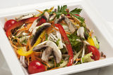 Fresh vegetable salad. With mushrooms in a white plate Royalty Free Stock Images