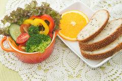 Fresh vegetable salad with whole wheat bread Royalty Free Stock Photos