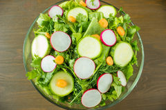 Fresh vegetable salad in a bowl. On wooden table Stock Photography