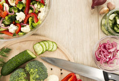 Fresh vegetable salad with broccoli, cauliflower, marinated cucu. Mbers, marinated red onions, sweet red pepper and dill. Fully raw food Royalty Free Stock Photography